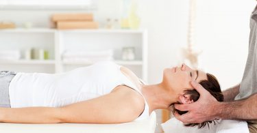 woman-laying-on-table-for-neck-treatment