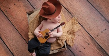baby-cowboy-sleeping-with-a-guitar