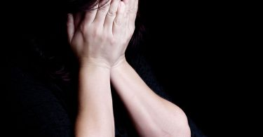 woman-crying-covering-her-face