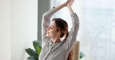 woman-stretching-at-work